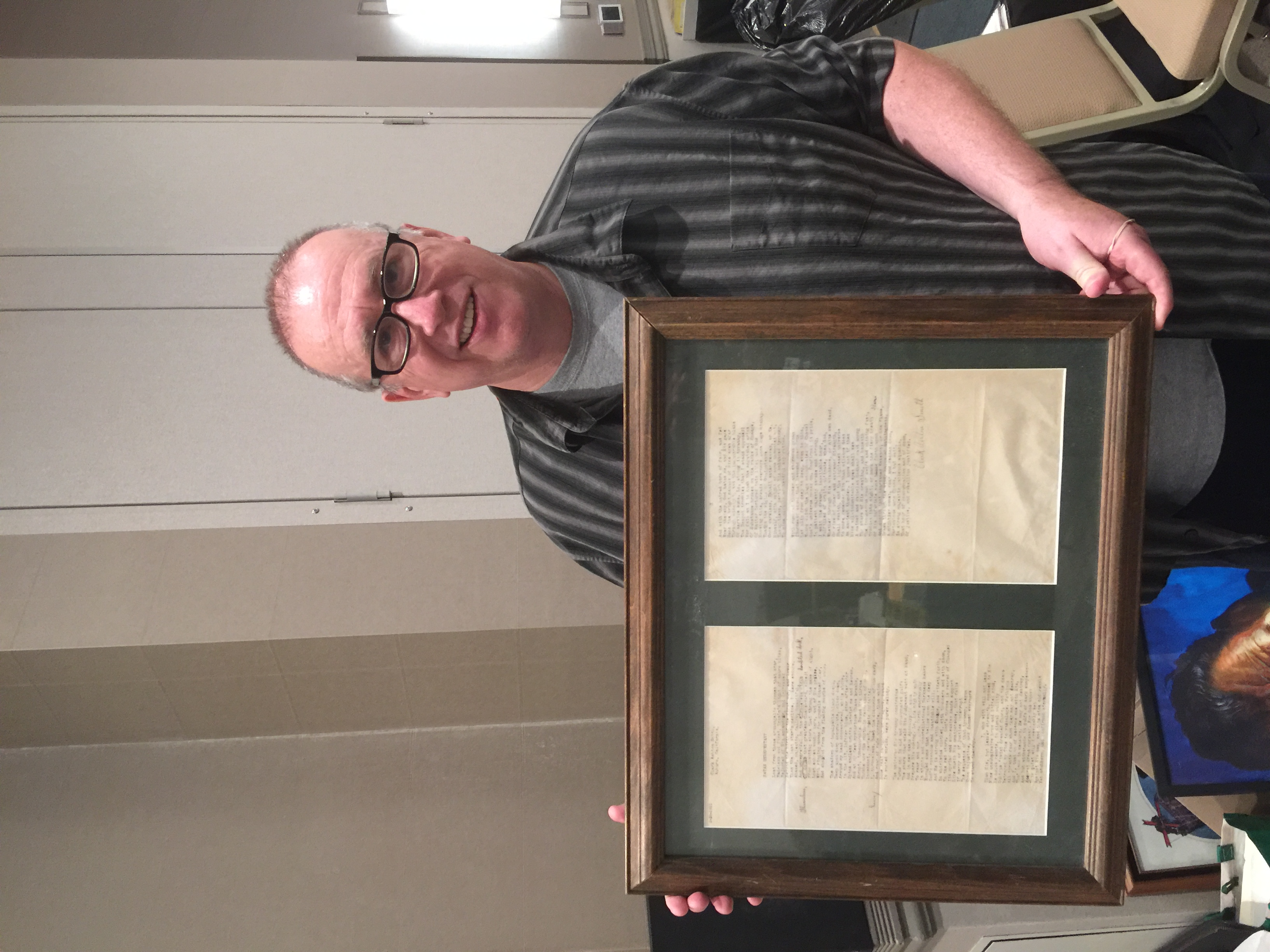 Scott Hartshorn holding an original manuscript of a Clark Ashton Smith poem